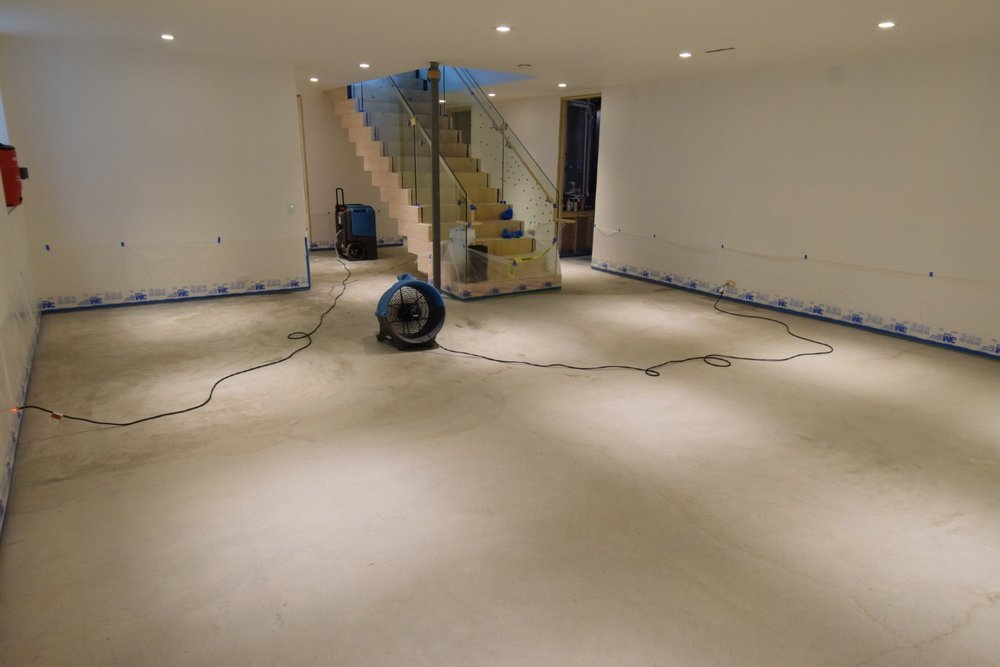 New, Custom-Home Basement Concrete Floor After Cleaning In Preparation For Acid-Staining