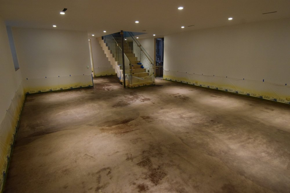 New Basement Concrete Floor Just After Applying Dark Brown/Black Acid Stain