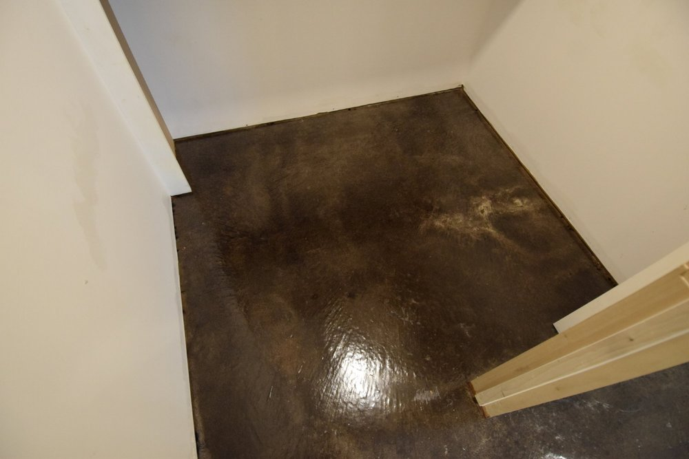 Black Acid-Stained Basement Concrete Floor Bedroom Closet With Clear Polyurea Sealer