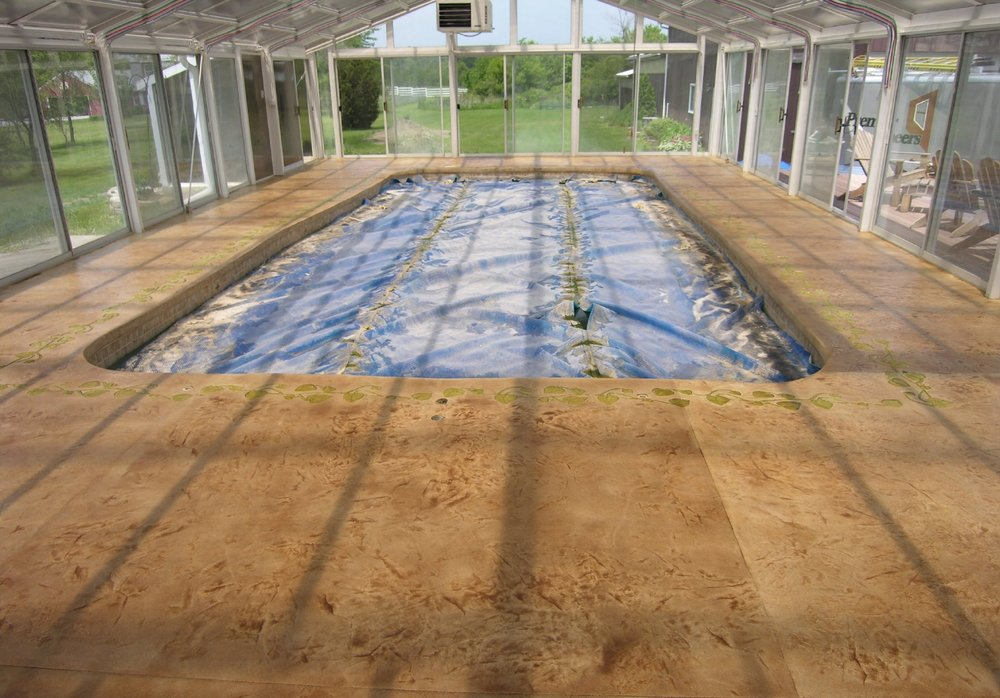 Acid-Stained, Stamped Decorative Cement Overlay Of Indoor Concrete Pool Deck