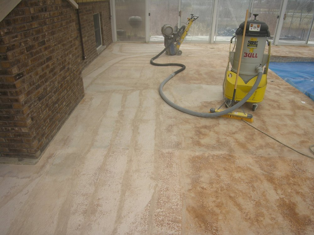 Failed Decorative Cement Overlay Of Indoor Concrete Pool Deck Being Removed By Scarifying