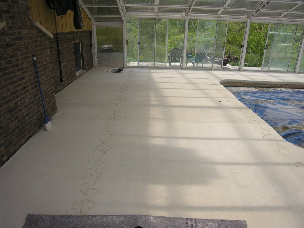 White Decorative Cement Overlay Of Indoor Concrete Pool Deck During Stamping Of Design