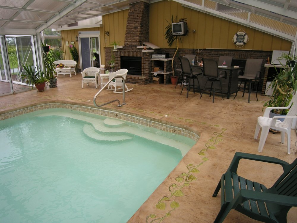 Award-Winning, Acid-Stained, Stamped Decorative Cement Overlay With Border Of Indoor Concrete Pool Deck After Sealing