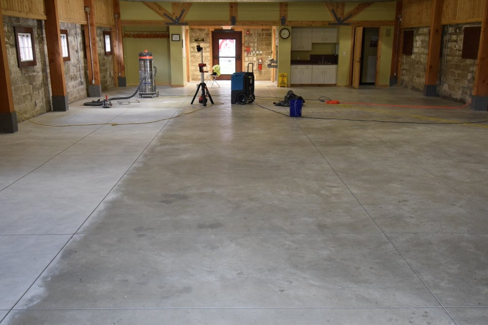 Unsealed, Discolored Museum Concrete Floor During Diamond Grinding