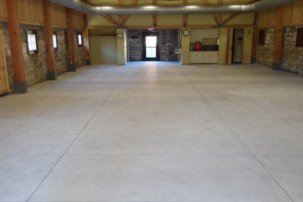 Museum Concrete Floor After Being Ground Clean To Apply Clear Polyurea Sealer