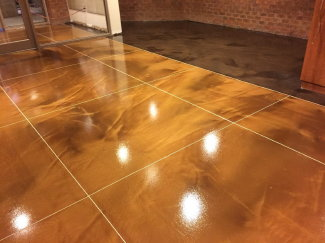 "Self-leveling epoxy, mixed with colored, metallic pigments, is used to create ""metallic epoxy"" flooring, an alternative to acid-stained concrete."