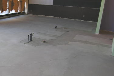 Concrete floors, like this one on the gorund floor of a high-rise in Chicago, are a perfect for self-leveling overlays, which remove all signs of repairs from plumbing or electrical upgrades.