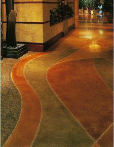 "Decorative scoring was done to this hallway section of an acid-stained concrete floor in a mall, with color separation, to create a ""leading effect"" for shoppers."