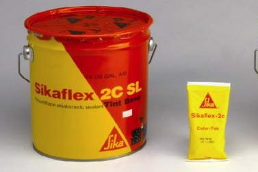 Sikaflex 2C is a high quality elastomeric joint sealant from Sika Corp, the world leader in construction sealant and adhesives.  2C is self-leveling and can be mixed with the small yellow color pack shown here for custom coloring.