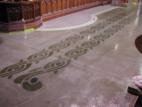 Blue and green acid stain were used for this concrete stencil pattern.  After rinsing the excess stain residue, a clear epoxy sealer was applied.