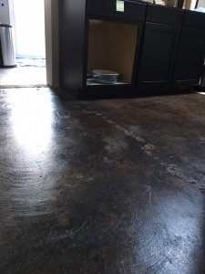 In 2016, Premier Veneers helped the owner of this poorly done, acid-stained concrete floor in West Bloomfield by an unlicensed contractor recoup $4,000 from the contractor.