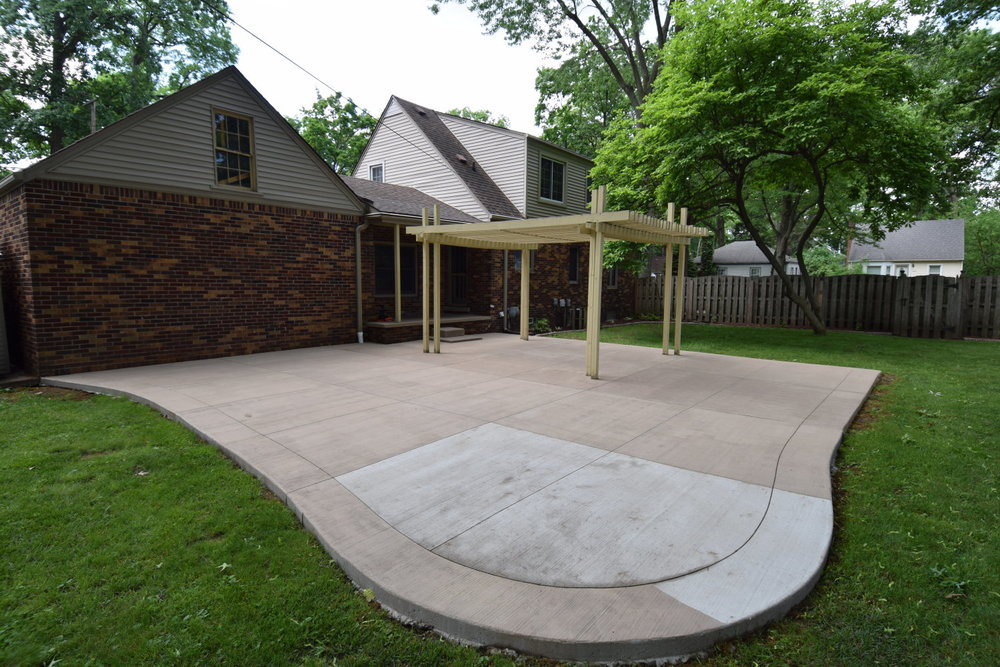 Concrete Patio During Application of Colored Cement Overlay