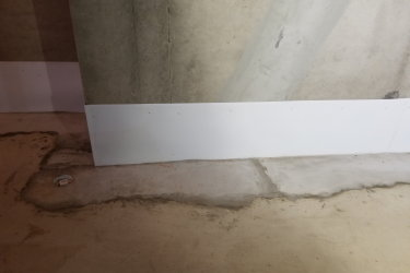 The basement of this new home in Royal Oak had a moisture problem due to the high local water table, and inadequate building procedures.  Drain tile subsequently had to be put in.  We tested the walls and floor to make sure the drain tile was working.