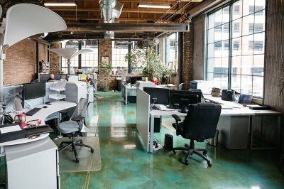This green & copper acid-stained concrete floor is the basis for strong Feng Shui (or Chi energy) in this corporate office space. The walls are also either concrete or brick, and these Earth elements are balanced by Wood elements used for the ceiling (wood rafters) and decor (plants throughout).