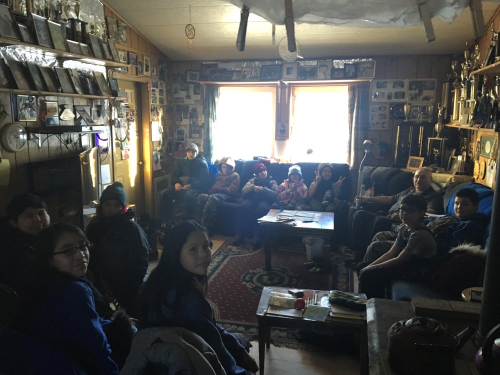 Huslia Junior HS students listening to Musher Wilson Sam telling stories.
