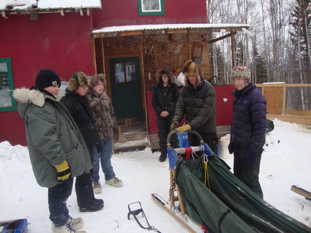 Eagle School students learn about the sled at Cranberry Kennel.