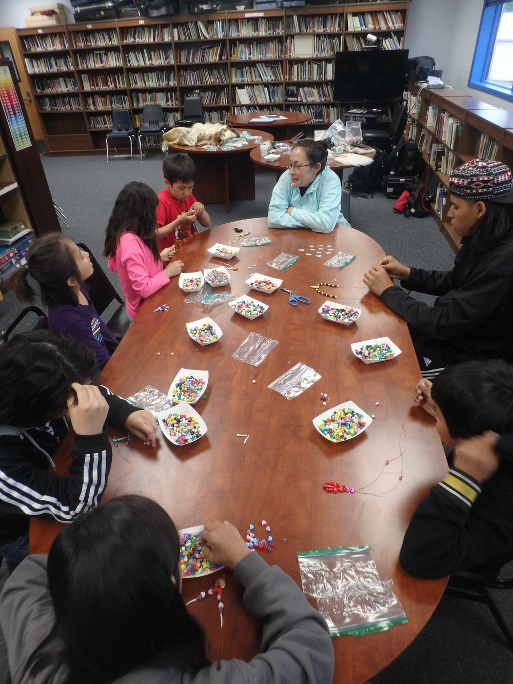 Minto School students learn to bead from Quest guest speaker.
