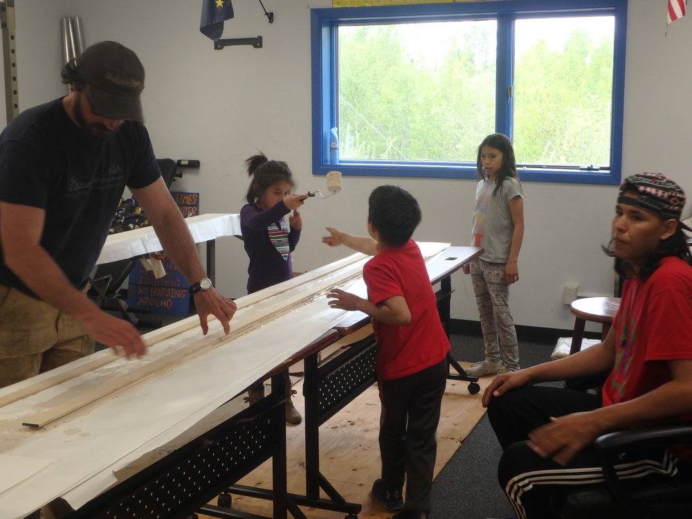 Minto School students learn how to make sled runners from Quest guest speakers.