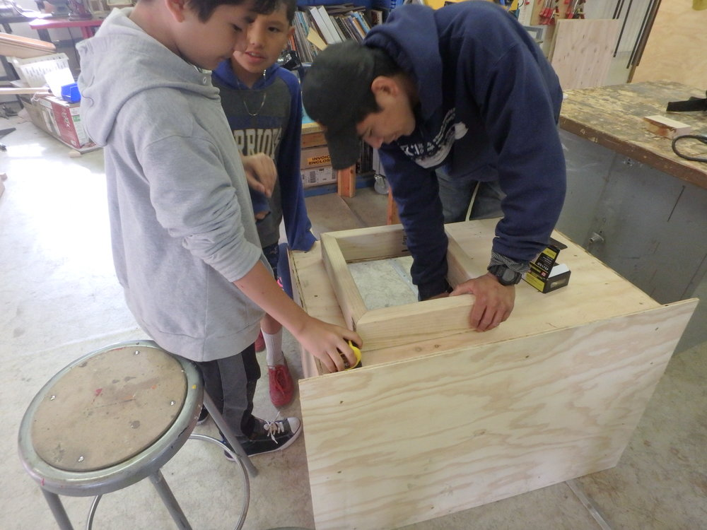 Minto School students learn to build a dog box.