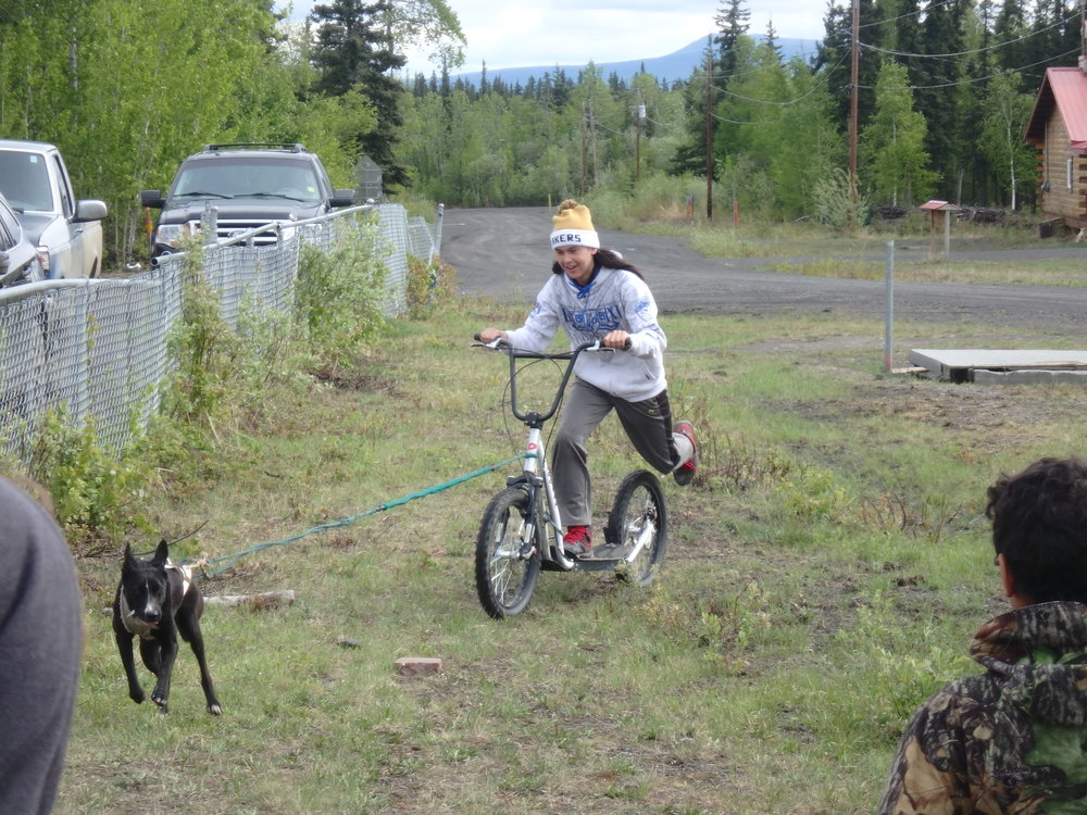 Minto School student learns how to bike with a dog.