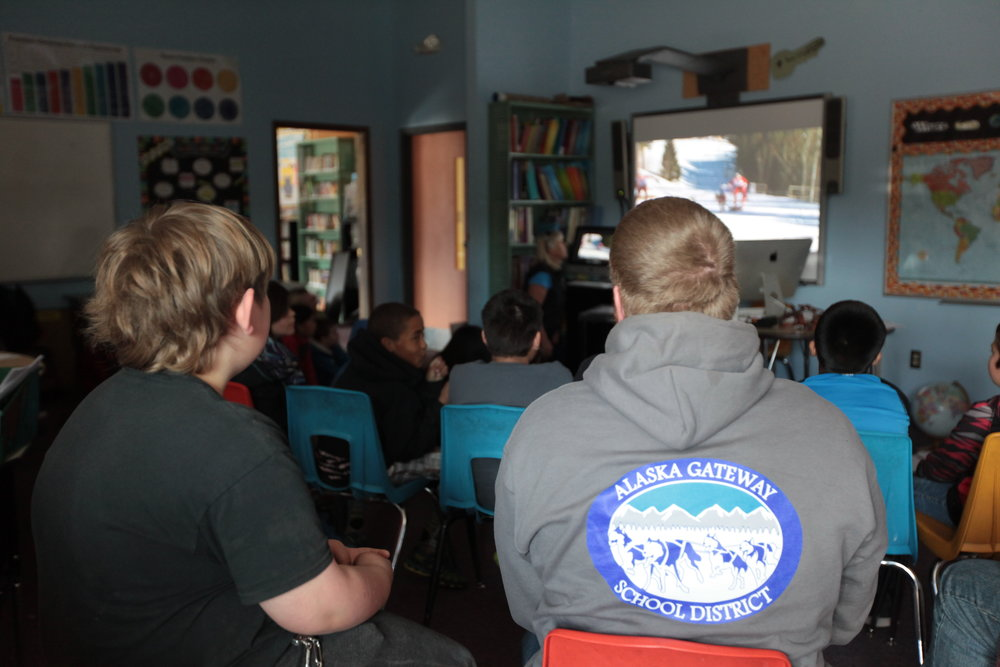 Eagle & Tanacross students listen to Quest guest speaker in classroom.