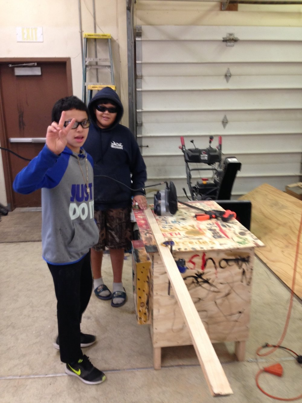 Students sanding runners.