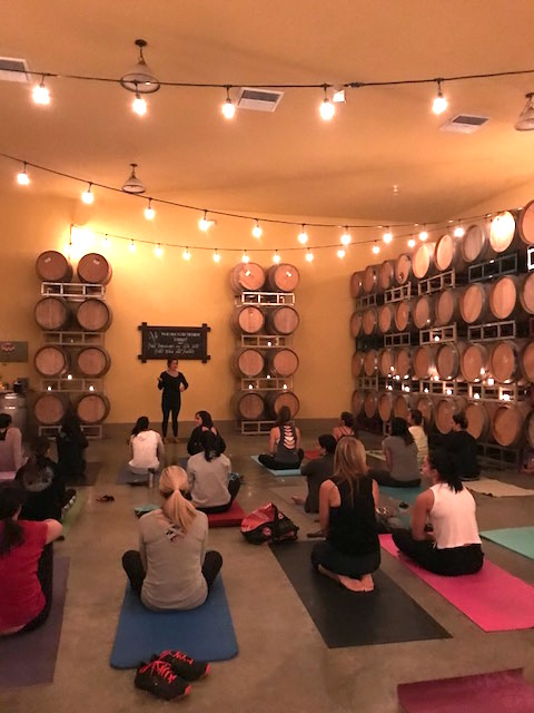 Yoga in the barrel room at McGrail Vineyards & Winery!