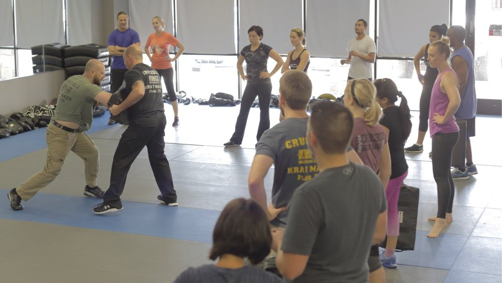 Mike Coffin, Chief Instructor at Crucible showing forward elbow strikes.