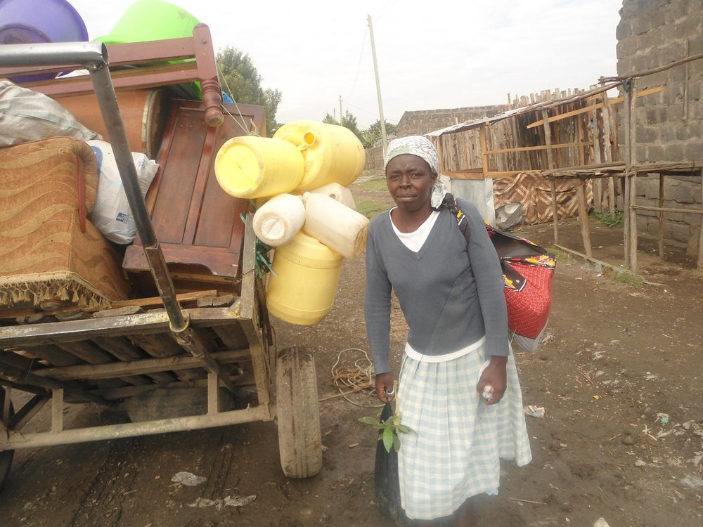 Grace Muthoni, one of the Shikamoo Housing Project beneficiary on her way to her new house. Photo Credits: Sammy Njuguna, Nakuru.