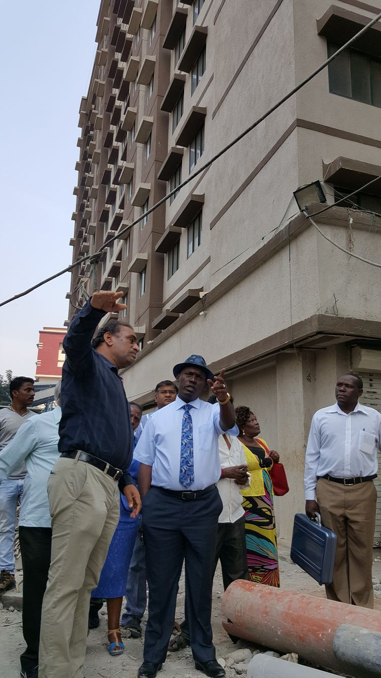 One of the developers explains a point to Governor Kabogo at one of the upgraded sites in Mumbai, India.