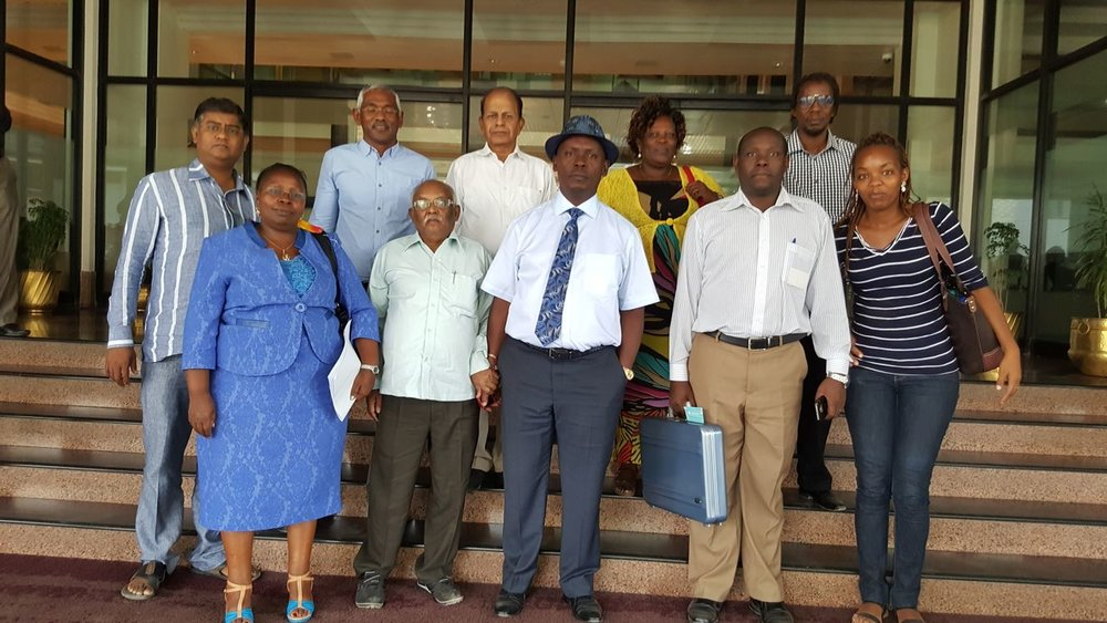 Members of SDI and H.E Governor William Kabogo of Kiambu County and members of his government pose for a group photo