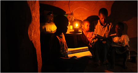 """A house hold using the """"Koroboi"""" lamp as a source of light. Photo: africagoodgovernancenow.org"""