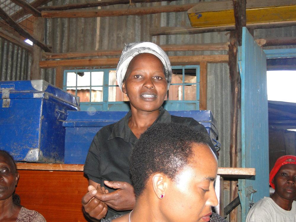 Standing: Pauline Manguru
