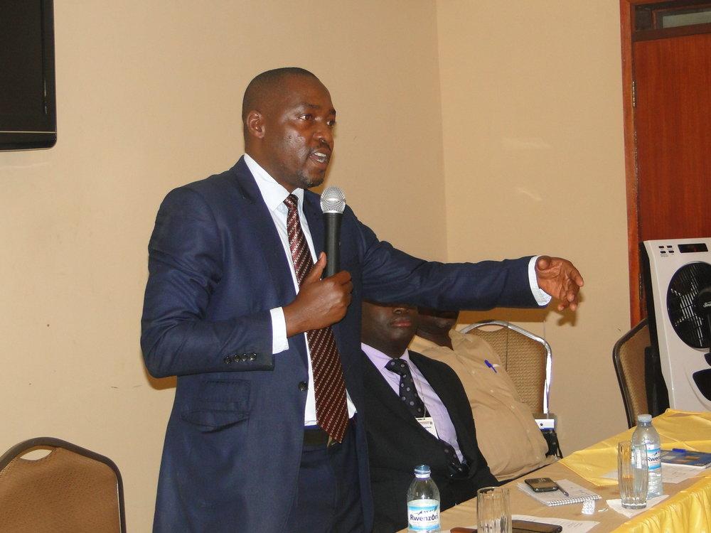 Mayor of Jinja Muhammad Baswari Kezaala officiating the Launch of the 9th Hub meeting