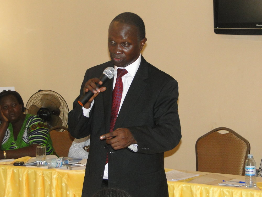 Hon. Daudi Migereko, Minister For Lands, Housing and Urban Development addresses the East African Hub participarnts
