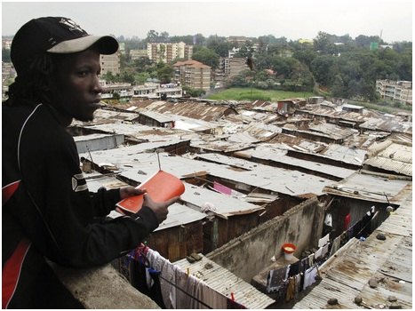 Isaac Mutisya, whom everyone knows as Kaka, points out the spot in Mathare where he was born. The more he maps his slum through the lens of his GPS, the more he feels the outside world is finally looking back. Gregory Warner/NPR