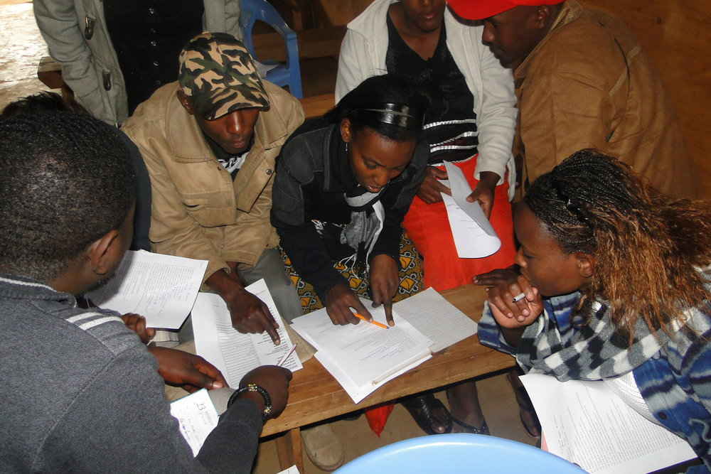 Savings group meeting in progress in Kiandutu Settlement