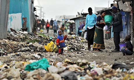 Kenyan slum residents stand amid strewn rubbish in the Mukuru slum, Nairobi, where women face routine attacks from sexual predators as they walk to the communal bathrooms. Photograph: AFP/Getty