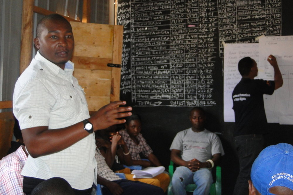 Baraka Mwau, the studio coordinators explains the possible impacts of the studio to Kiandutu community.