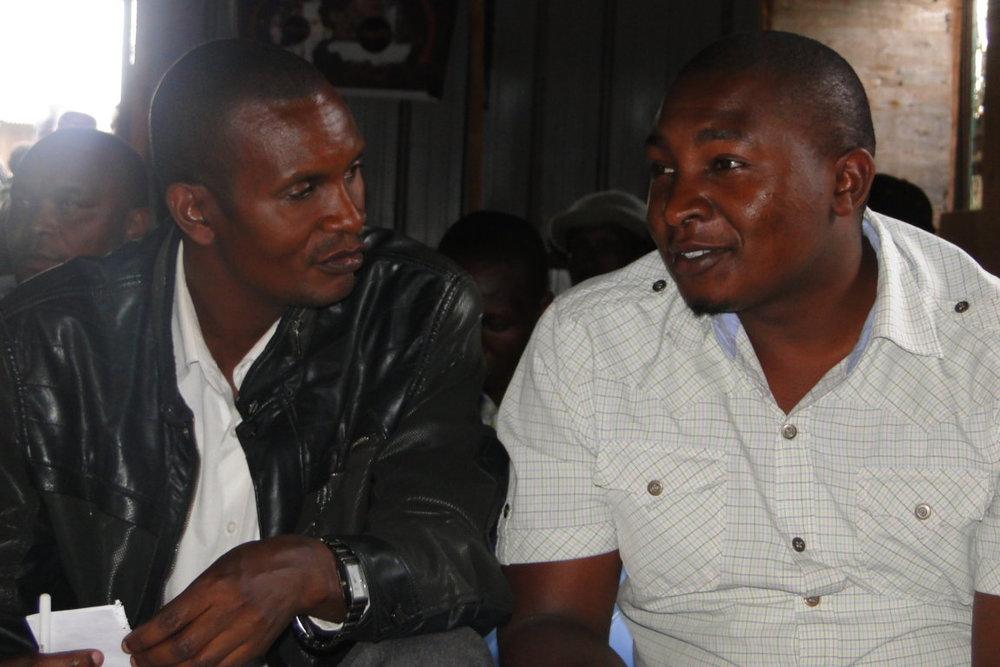 Rashid Mutua(Muungano Chair) exchange notes with Baraka Mwau on the studio.