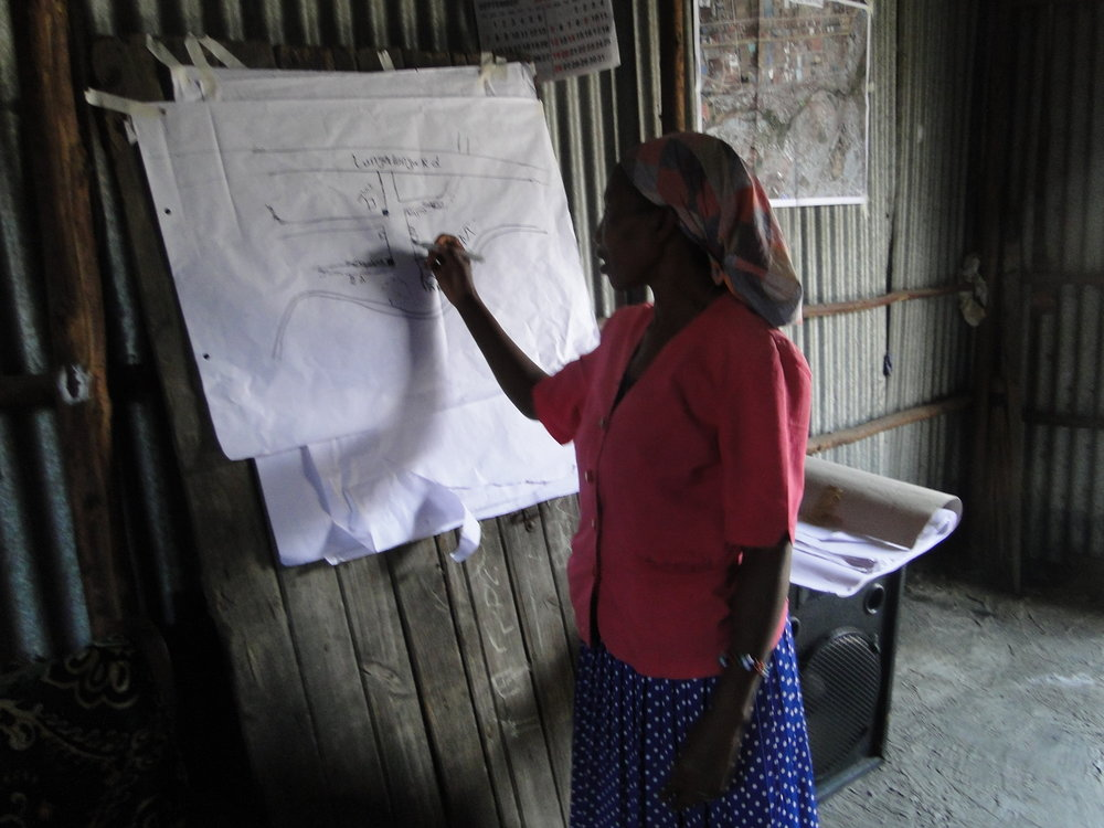 Mama Wairimu a Food Vendor in Milimani Village in Viwandani, draws a sketch Map of Viwandani representing food vendor concentration Areas