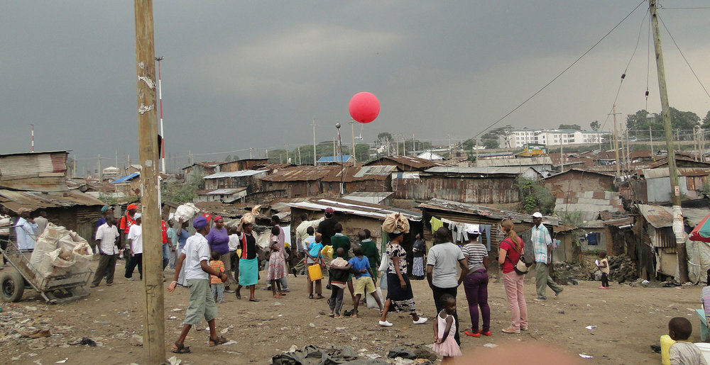 Researchers, Muungano members, and Mathare residents doing aerial balloon mapping.