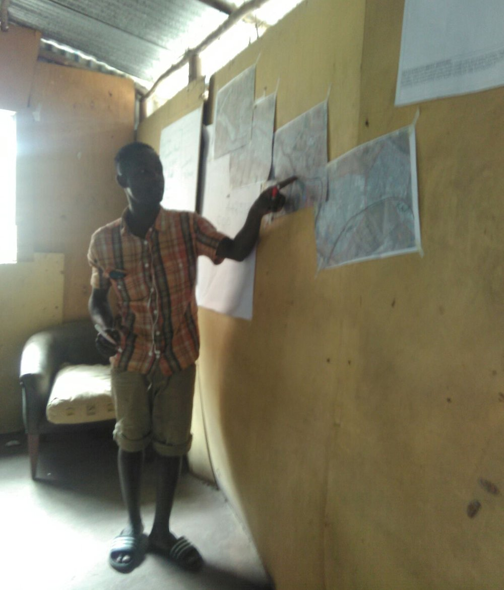 A youth from Mukuru Kayaba in Nairobi identifies some of the settlement boundaries.