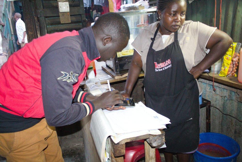 Conducting the survey in Mukuru Kwa Reuben Segment 1. Photo: Muungano, Know Your City TV