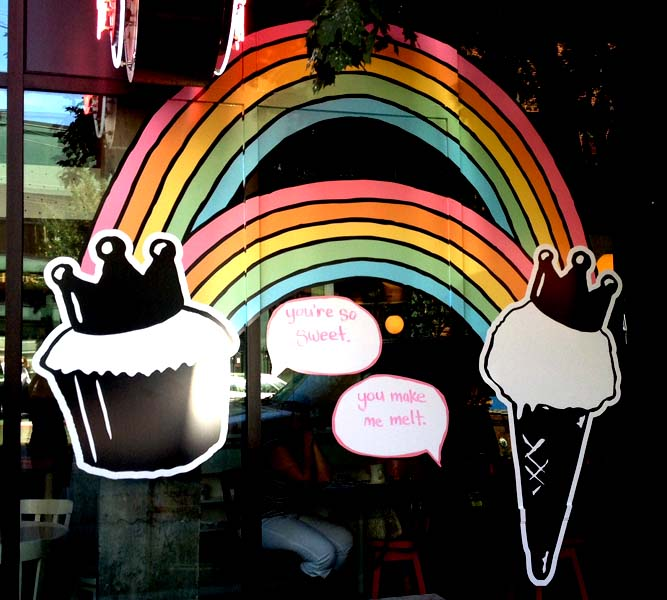 """Promotional Signage Double Rainbow with a Cupcake and Ice Cream Cone in Crowns. """"You're so sweet."""" & """"You make me melt."""""""