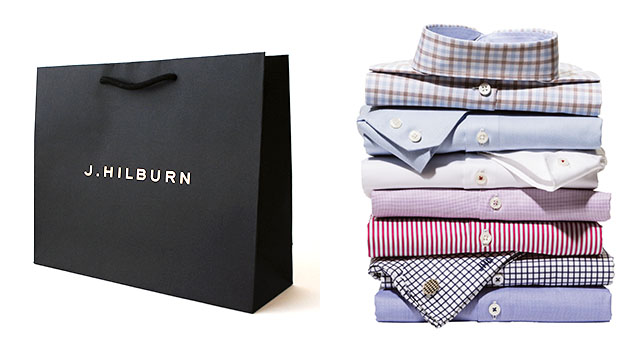 J.Hilburn Bag and a stack of collared shirts