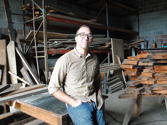 Brackish Designs Andy Whitcomb in his wood working studio