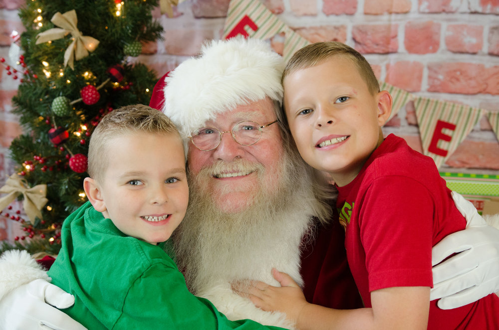And of course my sweet baby monkeys love having their photo with Santa.  They think it's pretty cool that he makes a special visit to let mommy take pictures of him each year!  :)