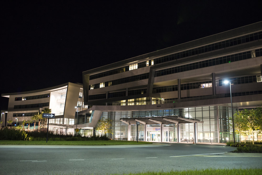 UF Health North building at night. Inside is the UF Birth Center, where pregnant moms can use natural labor to birth their babies with midwives.