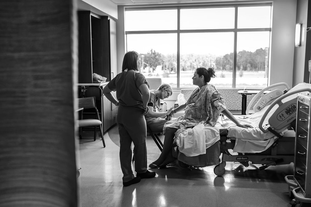 A nurse at UF North in Jacksonville inserts an IV for an expecting mom. She had planned on having a VBAC, but when faced with preeclampsia, made the decision for a gentle C-section.